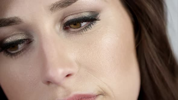 Thumbnail for Close up of woman's face as she tilts head.