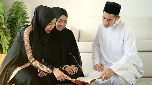 Asian Muslim Family Praying at Home