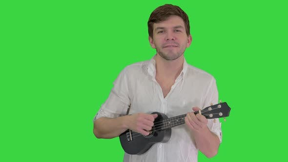 Thumbnail for Man with Ukulele Singing a Song on a Green Screen, Chroma Key