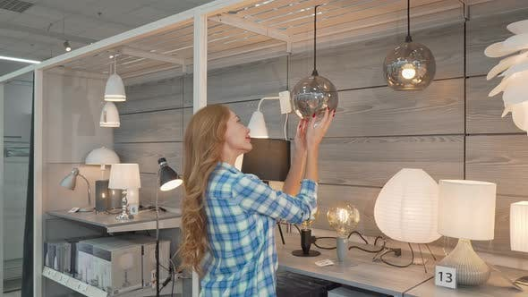 Thumbnail for Rear View Shot of a Female Customer Choosing Lamps at Furniture Store