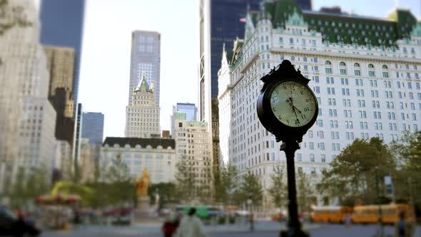 Timelapse of Watch Clock Showing Time in Urban City District