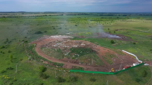 Aerial Top View of A Huge Waste Garbage Dump Rubbish Landfill