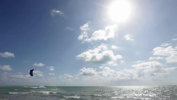 Thumbnail for Young man kitesurfing