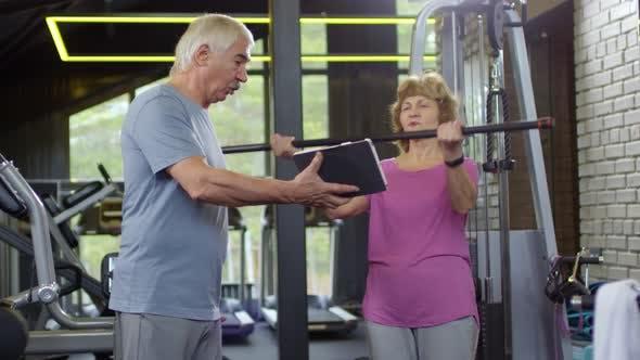 Cover Image for Elderly Woman Exercising Using Bodybar
