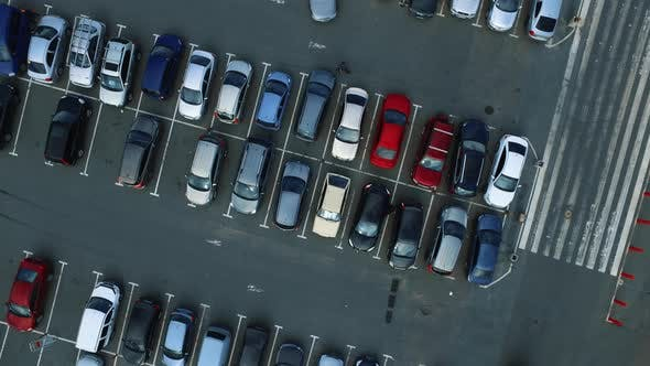 Thumbnail for Drone Flying Over Parking Near Mall. Copter Filming People Walking at Parking