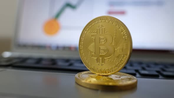 Thumbnail for Golden bitcoin and US dollar in spinning