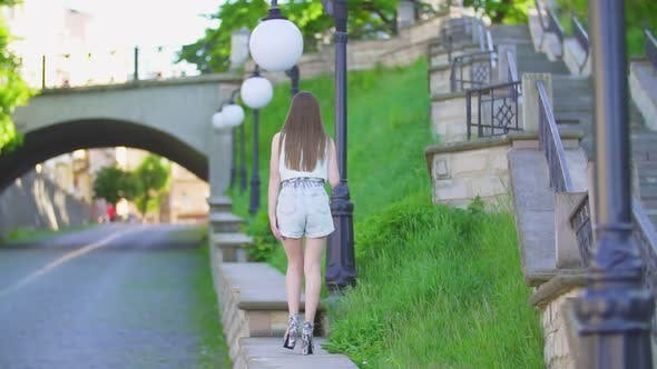 Girl in Shorts with Long Hair
