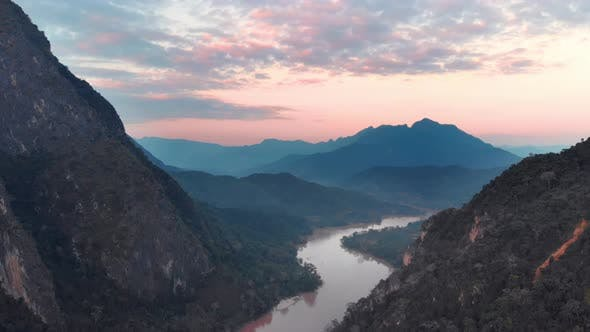 Thumbnail for Aerial: flying over Nam Ou River Nong Khiaw Muang Ngoi Laos, sunset dramatic sky