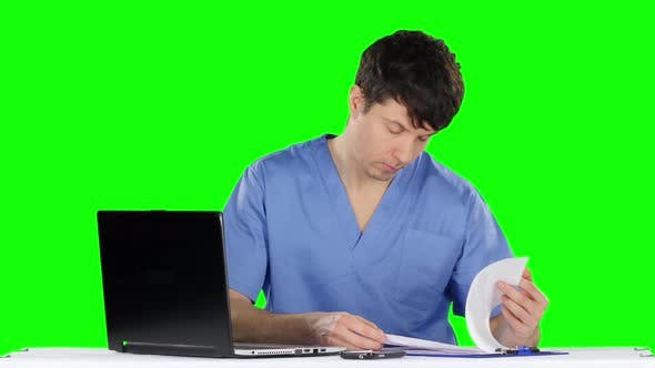Thumbnail for Doctor Uses a Computer and Talking on the Phone. Green Screen