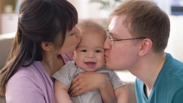 Cover Image for Happy Family with Baby Boy at Home