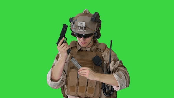 Thumbnail for Soldier of Army Elite Forces Walking and Shooting with Pistol on a Green Screen, Chroma Key.