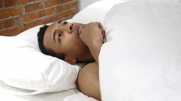Thumbnail for African Man in Lying in Bed Thinking and Imagining at Night