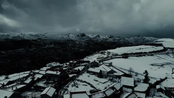 Thumbnail for Snow Covered Remote Village in the Mountains at Night