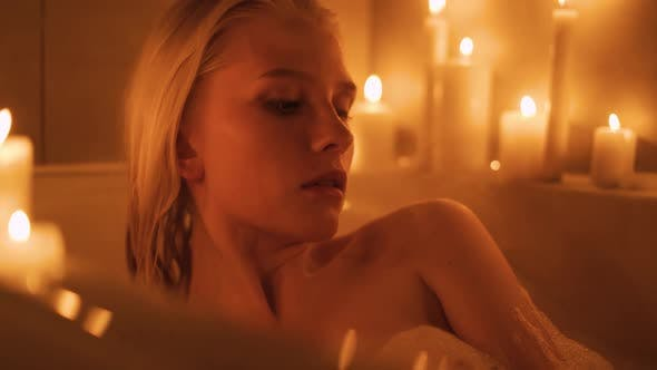 A Woman Lies in a Hot Bath By Candlelight
