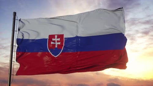 Flag of Slovakia Waving in the Wind Against Deep Beautiful Sky at Sunset