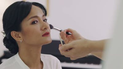 Asian Wedding Makeup Artist Making A Make Up For Bride. Artist Applying Cosmetic On Bride Face.