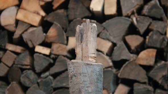 Thumbnail for Chopping Wood with an Axe in Woodpile - Axe Gets Stuck in the Log