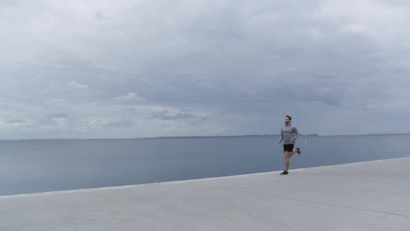 Thumbnail for Athlete Running Along Promenade