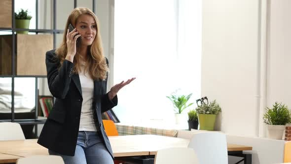 Thumbnail for Talking on Smartphone by Businesswoman Sitting on Desk, Call