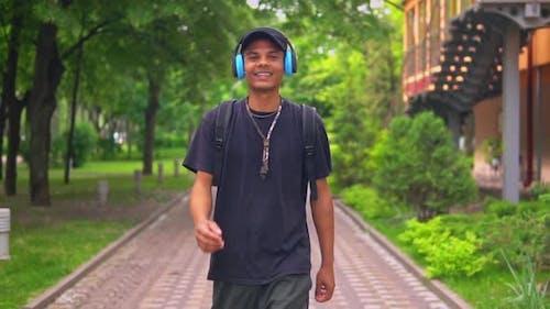 Joyful Male with Headphones Outdoors