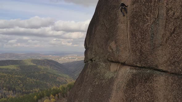 Thumbnail for Risky Climb on a Rock Crack on a Vertical Wall.