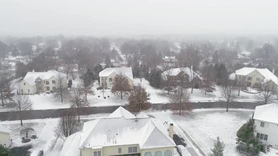 Thumbnail for Aerial View of the Suburbs of Pittsburgh During Cold Winter Afternoon When Snow Covering Everything