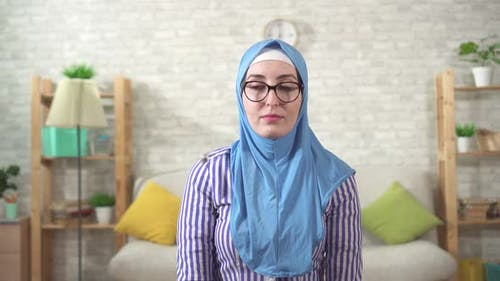 Muslim Woman During a Hypnosis Session in the Psychologist's Office