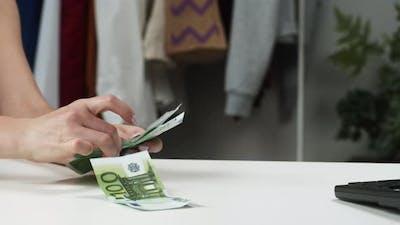 Counting Hundred Euro Banknotes at Shop
