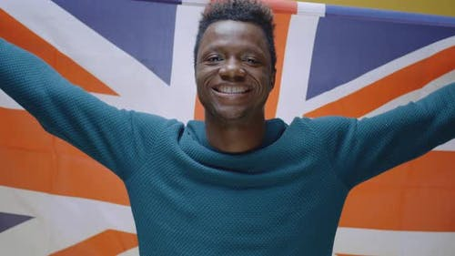 Young Man Raising the Union Jack