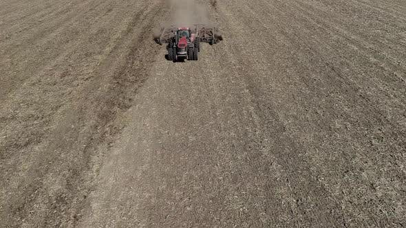Thumbnail for Tractor Cultivating Field at Spring