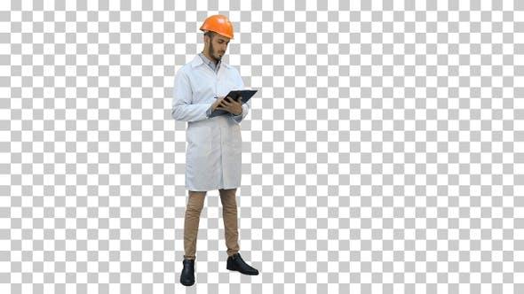 Civil engineer in white coat preparing report, Alpha Channel