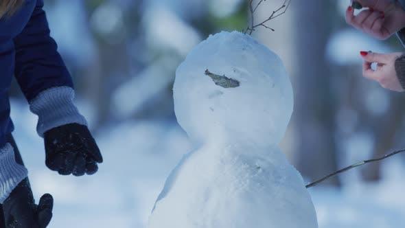 Thumbnail for Building a snowman