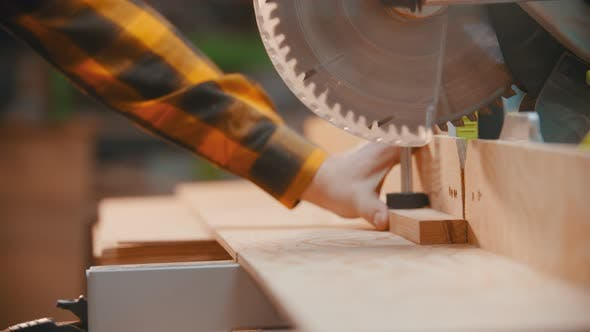 Thumbnail for Carpentry - a Woodworker Cutting the Wooden Detail with a Sharp Circular Saw - Cutting Out a Little