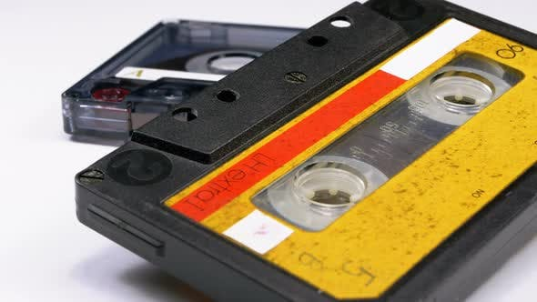 Cover Image for Two Vintage Audio Cassette Rotates on White Background