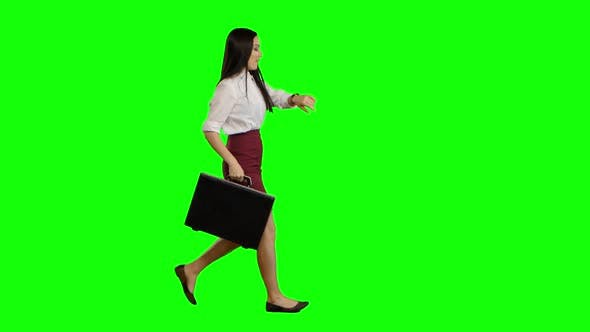 Thumbnail for Asian Girl with a Briefcase in Her Hands Is Running for Talks. Green Screen