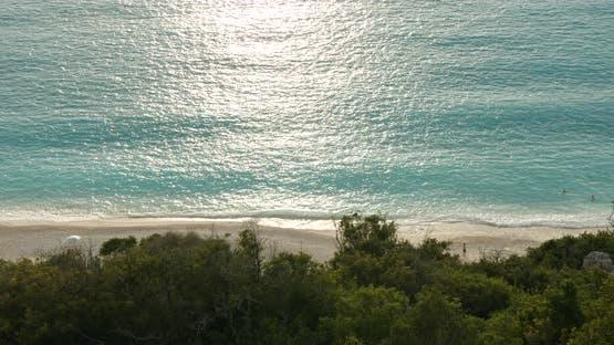 Sandy Beach with Last Sun Light in Summer Day
