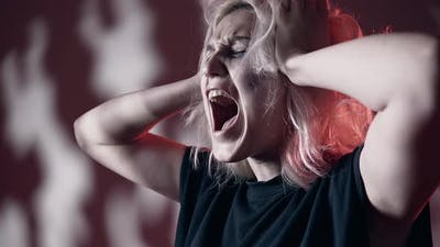 Scared Desperate Woman Screaming and Covering Ears