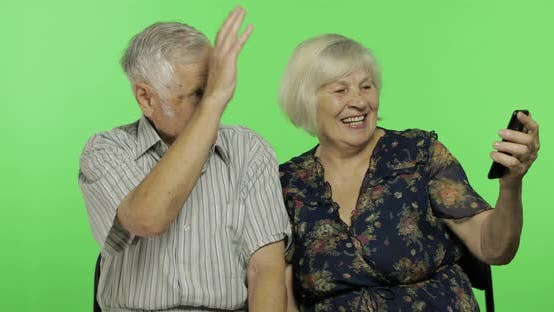 Thumbnail for Senior Aged Man and Woman Having Video Chat Using Smartphone. Chroma Key