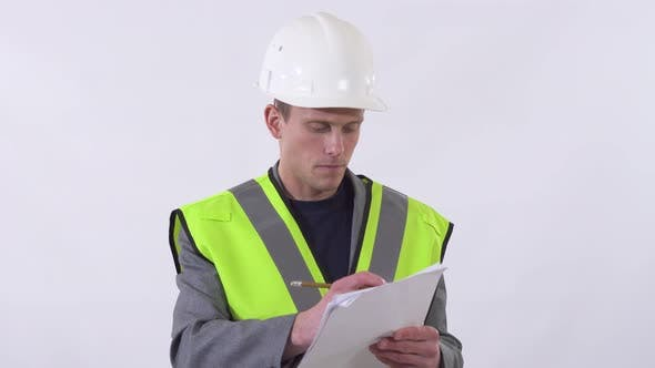 Thumbnail for Portrait of Builder in Uniform Writing on Paper and Giving Orders