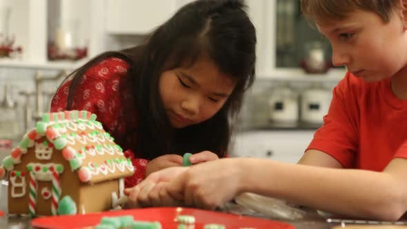 Thumbnail for Decorating gingerbread house for Christmas