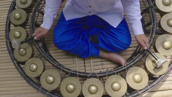 Playing Circle Gong Thai Traditional Music Instrument