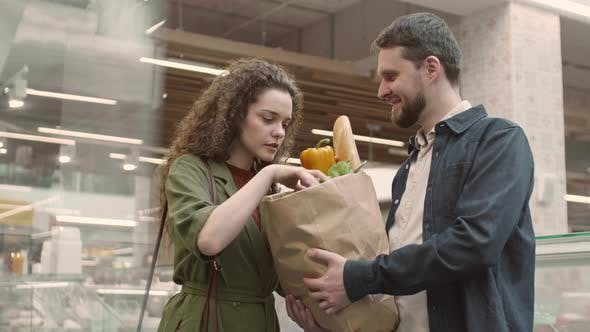 Young Couple Having Shopping in Food Market