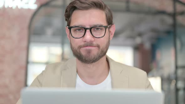 No Gesture By Head Shake By Man with Laptop