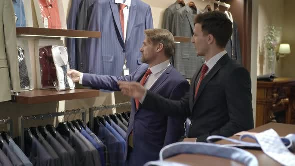 Thumbnail for Men in Suits Shopping in Menswear Boutique