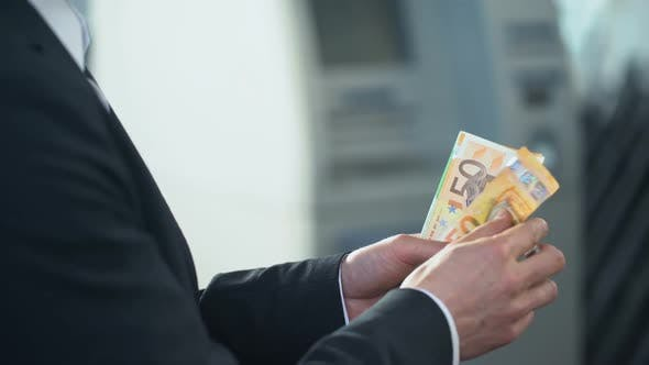 Thumbnail for Businessman Counting Euros He Wants to Send to Family, Quick Money Transfers