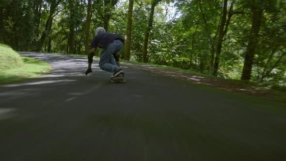 Thumbnail for Skateboarder on summer day