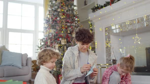 Thumbnail for Family Making Christmas Paper Origami at Home