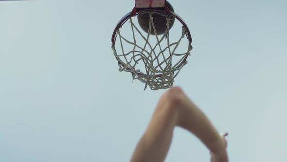 Thumbnail for Basketball Going Through Outdoor Basketball Hoop
