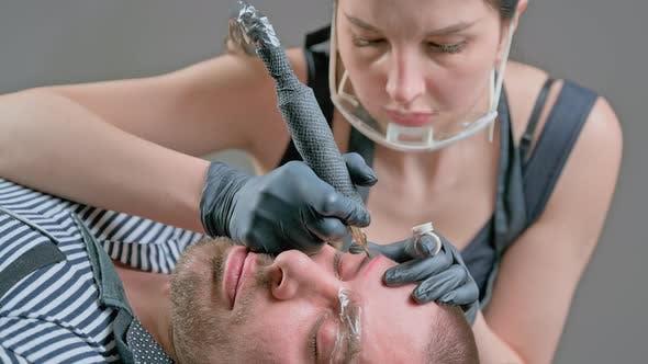 Master Beautician Does Eyebrow Tattoo