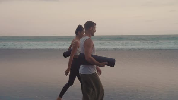 Thumbnail for People Carrying Yoga Mats on Beach